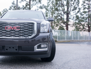 The 2018 Yukon Denali's gets a new, more sculpted grille.
