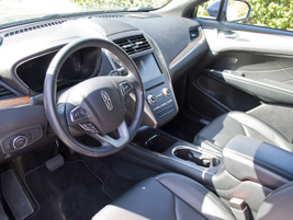 The interior features leather surfaces and a premium infotainment system.