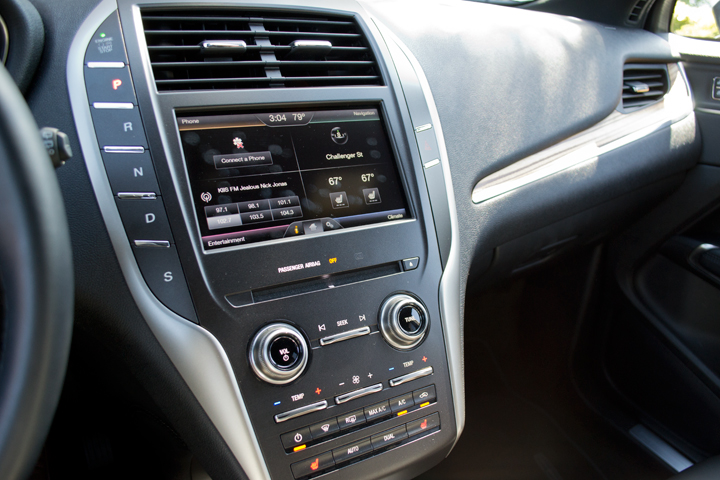 Shifting is done via several push buttons to the left of the dash screen.
