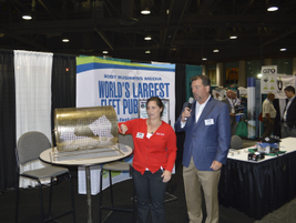 Bob Brown Jr. and Kristen Messineo of Bobit Business Media hold a raffle for attendees in the...