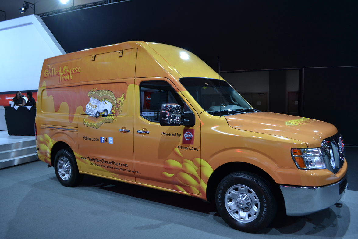 A Nissan Cargo Van is put to use as a food truck.