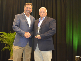 Bob Brown Jr. presents a fleet sustainability award to Bart Wyss of University of Pittsburgh...