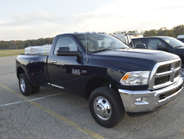 A 2016 Ram 3500 SLT Regular Cab 4X4 Long Box loaded with 6,000 pounds.