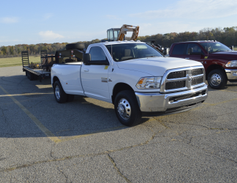 A 2016 Ram 3500 SLT Regular Cab 4X2 Long Box towing a 31,135 pound trailer.