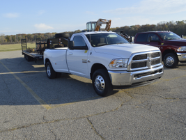 A 2016 Ram 3500 SLT Regular Cab 4X2 Long Box towing a 31,135 pound trailer.