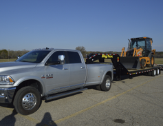 A 2016 Ram 3500 Limited Crew Cab 4X4 Long Box towing a 27,675 pound trailer.