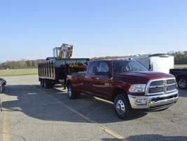 A 2016 Ram 3500 Big Horn Crew Cab 4X4 Long Box towing a 20,820 pound trailer.