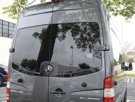 The rear doors of all the passenger vans are held open by heavy-duty, U.S.-grade magnets to...