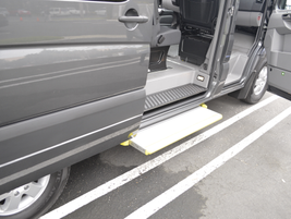 This Sprinter 2500 includes the optional side door passenger step.