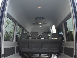 Looking into the rear of the extended-length passenger van shows ample cargo space while seating...
