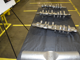 The 90-pound bar in the foreground is the type used to create a finished crankshaft similar to...