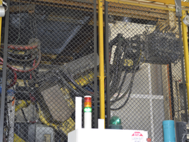 This is an example of one of the robotic systems used in the Decherd Powertrain Plant. Many of...