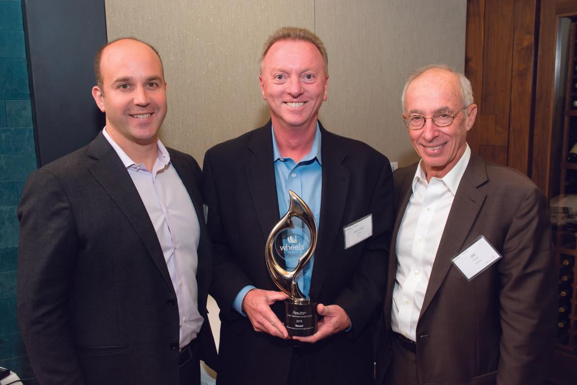 Congratulating William Davis, fleet & DOT manager, U.S, & Canada at Recall (center) is Dan...