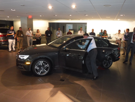 Timo Klotz, an Audi product planning analyst, shows off the A4 2.0T Ultra, a higher fuel economy...
