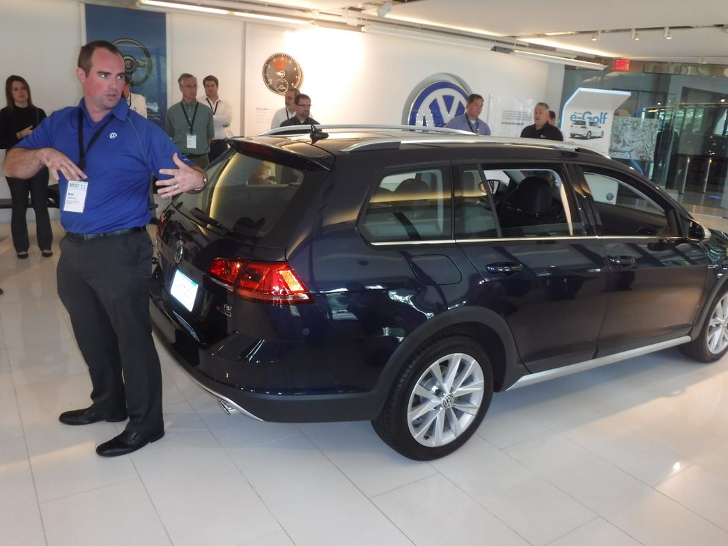 Matt Lockwood, VW's sales curriculum designer for the VW Academy, shows off the Golf Alltrack SE.