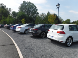 A line of vehicles wait to be driven away from the sporting museum.
