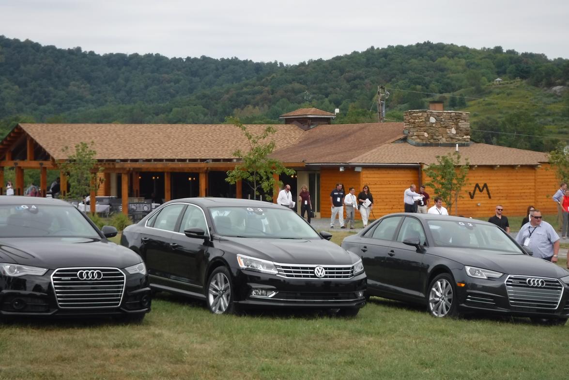 An Audi A8 LWB 3.0T Quattro, Volkswagen Passat 1.8T R-Line, and Audi A4 2.0T Quattro sit at...