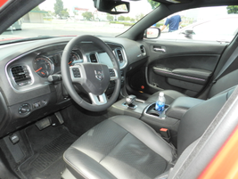The Charger features a three-spoke steering wheel and a 7-inch gauge cluster.