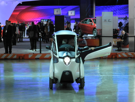 A single seat concept vehicle from Toyota zipped around a basketball court sized test track.