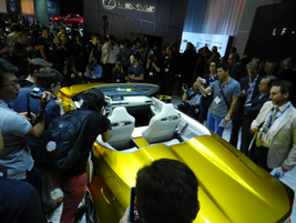 The press clamoring to get a shot of the golden LF-C2 concept car after the official unveiling.