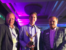 (l. to r.) Automotive Fleet's Mike Antich, 2016 Fleet Executive of the Year Dean Ahart, and CEI...