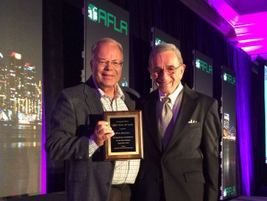 Phil Procida (right) was one of three inductees to the 2016 Fleet Hall of Fame.