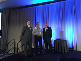 (l. to r.) Rich Wilson, Omnitracs' senior sales manager; Ken Marvenko director of safety and...