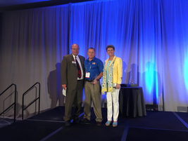 (l. to r.) Mike Antich, editor of Automotive Fleet; Joe Rader (who won the Fleet Safety Award);...