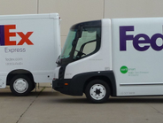 A FedEx Express Freightliner eCell and a Navistar eStar.