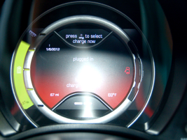 The Fiat 500e's instrument panel shows the vehicle's state of charge, a trip summary, and how to...