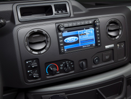 The interior on this E-150 XLT shows Ford's optional driver information center.