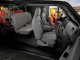 Pictured is a look at the E-Series Crew Van upfit package. The crew van models can seat up to...