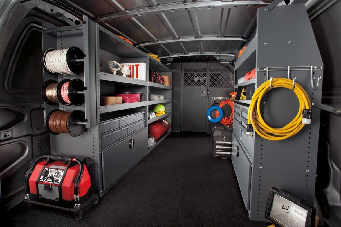In the rear of this E-Series cargo model, the van is upfitted with the Racks and Bins Upgrade...