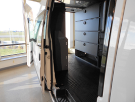 A view through the side door of the Transit.