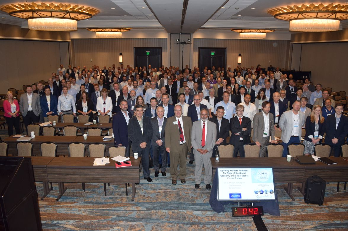 """The attendees of the Global Fleet Conference pose for a """"class photo"""" after the opening keynote..."""