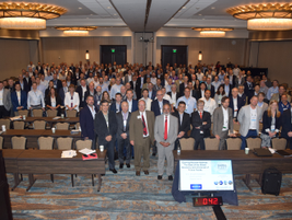 "The attendees of the Global Fleet Conference pose for a ""class photo"" after the opening keynote..."