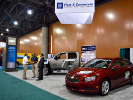 Chevrolet Cruze powered by clean diesel fuel is in the front. In the back is the 2014 Chevrolet...