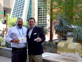 Daryl Greenlee, City of Orlando, accepts a prize from Robert Brown, Green Fleet Conference...