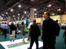 As the 70,000 sq.-ft. exhibit hall opened, the more than 600 attendees poured in to check out...
