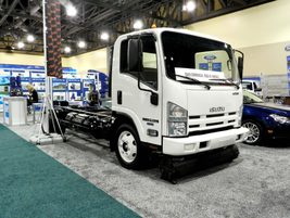 This 14,500-lb. Isuzu NPR HD gas truck has been converted with an IMPCO bi-fuel CNG system. It...