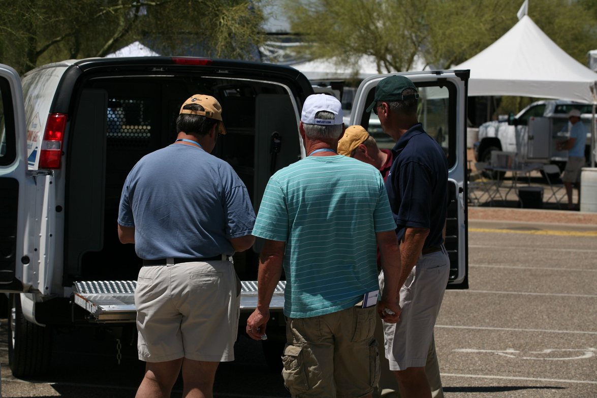 Attendees look at the upfit options in a GM van.