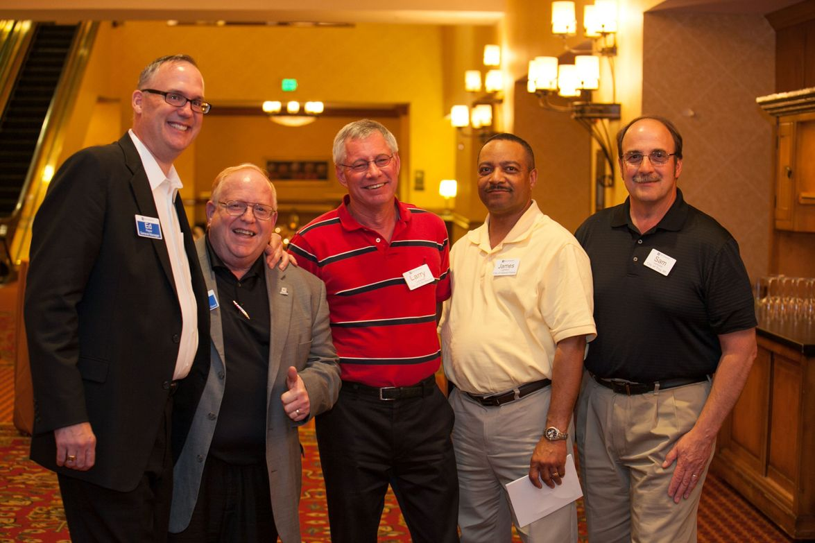 GM's Ed Peper (left) stands with the City of Fort Wayne's Larry Campbell (middle) and the City...