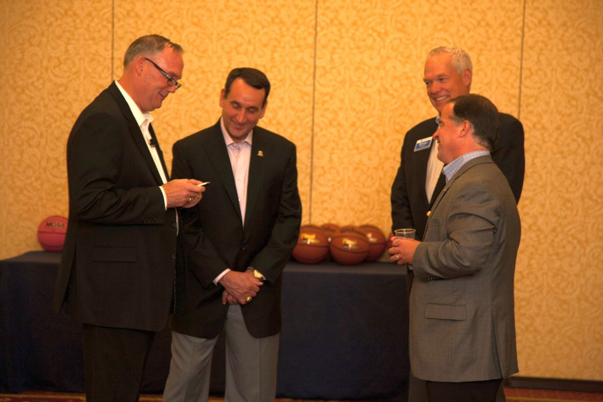 GM's Ed Peper (L), Tony DiSalle (right), and Brian Bowden (far right) spend time with keynoter...