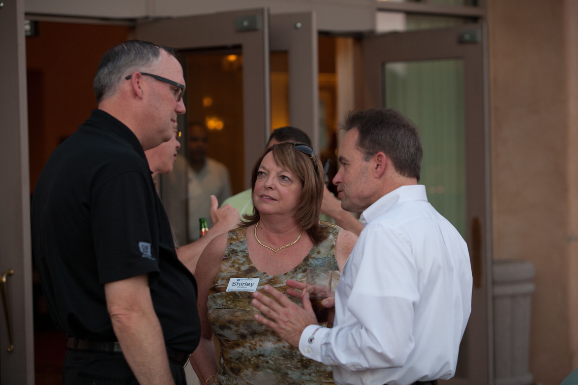 GM's Ed Peper speaks with Shirley Collins from GlaxoSmithKline and another attendee.