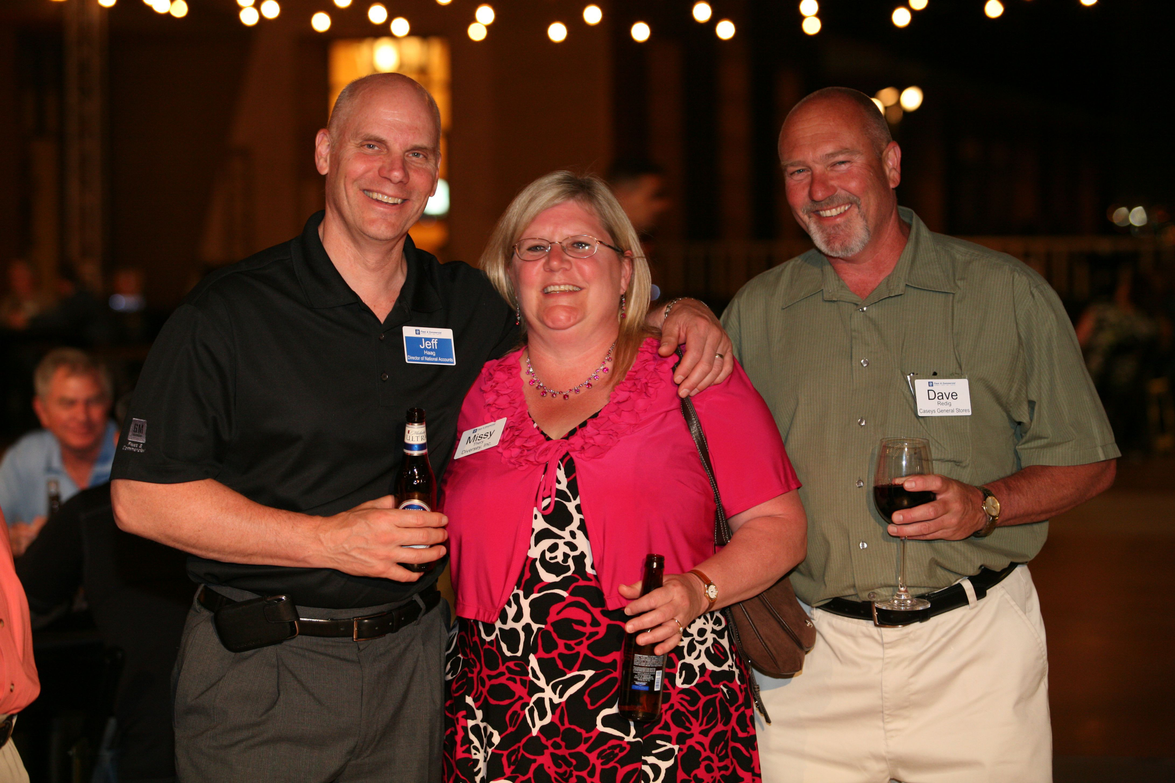 GM's Jeff Haag (left) shares a memory with Dave Redig of Casey's and an unidentified fleet manager.