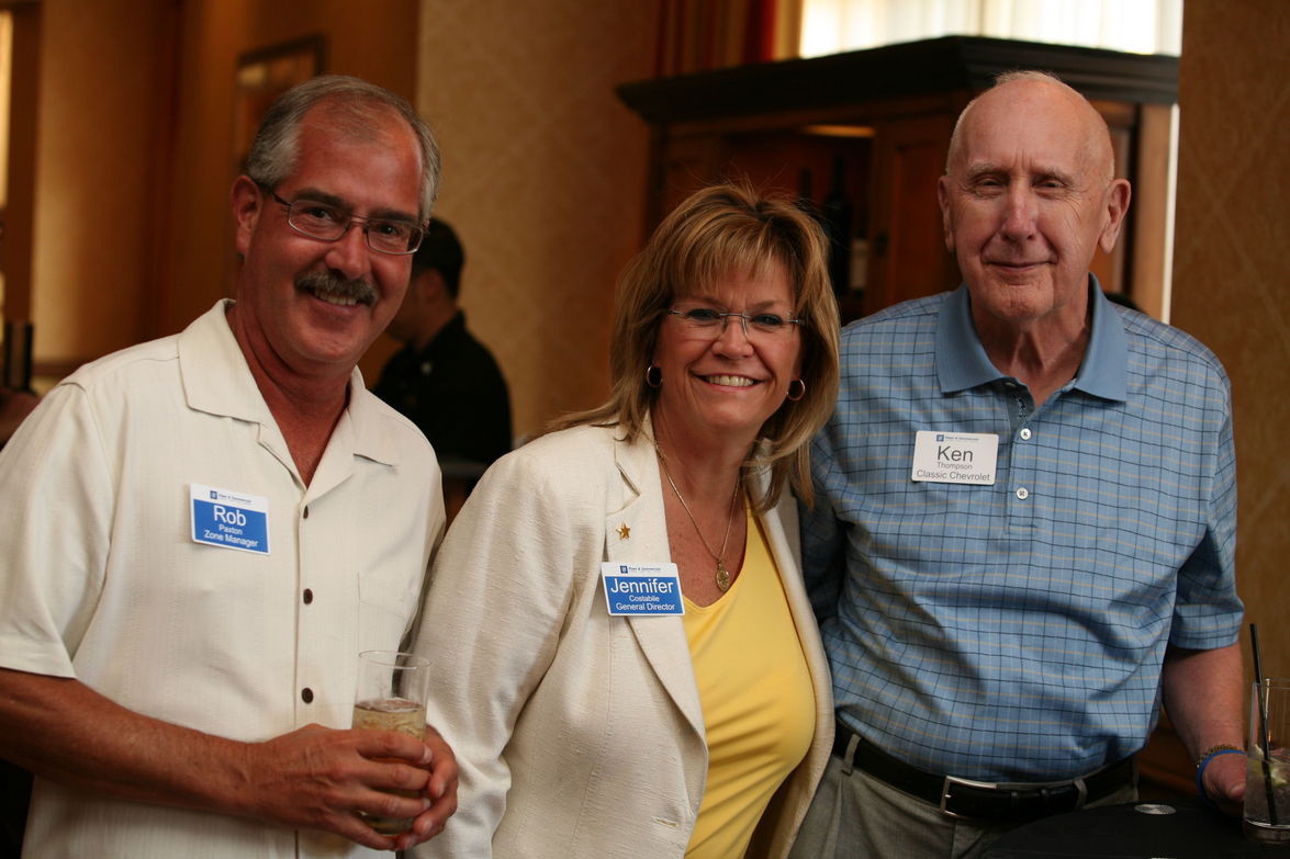 (L-R) GM's Rob Paxton and Jennifer Costabile spend time with  Ken Thompson of the Thompson...