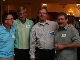 GM's Ted Pfister (third from left) spends time with Marty Burr (far left), Dan Devries of...