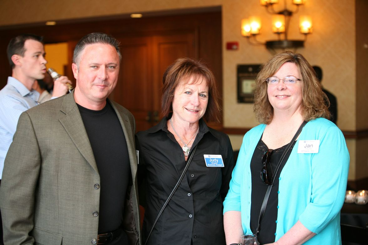Mike Whelan of Wheels Inc. (left), GM's Judy Brophy (center) and Jan Freund of Wheels Inc. take...