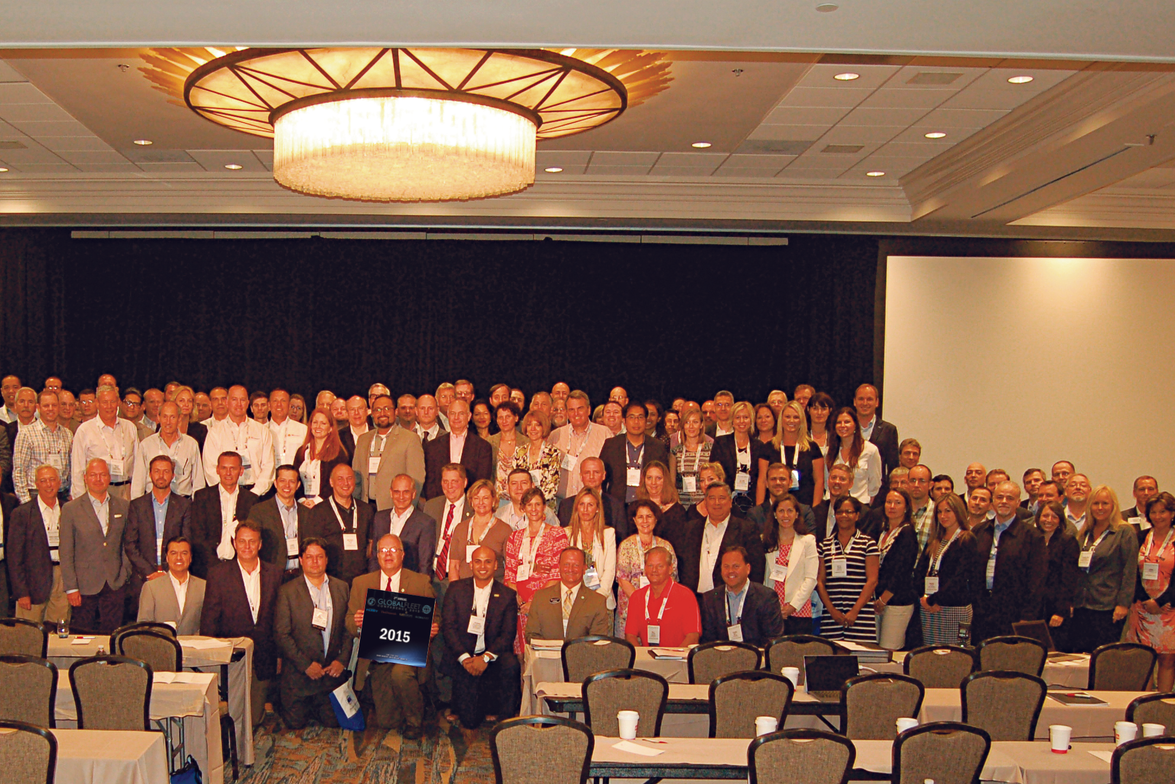 """Attendees of the third annual Global Fleet Conference pose for a """"class"""" picture to commemorate..."""