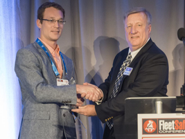 HDT Executive Editor David Cullen (right) presents Nussbaum Transportation's Jeremy Stickling...